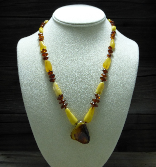 <u>Baltic Amber Necklace - Polished Custard & Cognac Pendant</u><br>$34.47 w/ discount code: 25