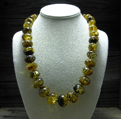 <u>Baltic Amber Necklace - Polished Yellow/Green & Black</u><br>$206.21 w/ discount code: 25