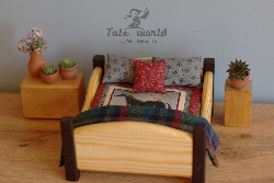 Wooden bed with bedding